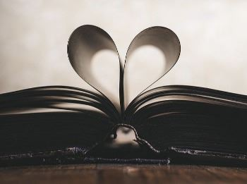 book with pages folded into a heart=